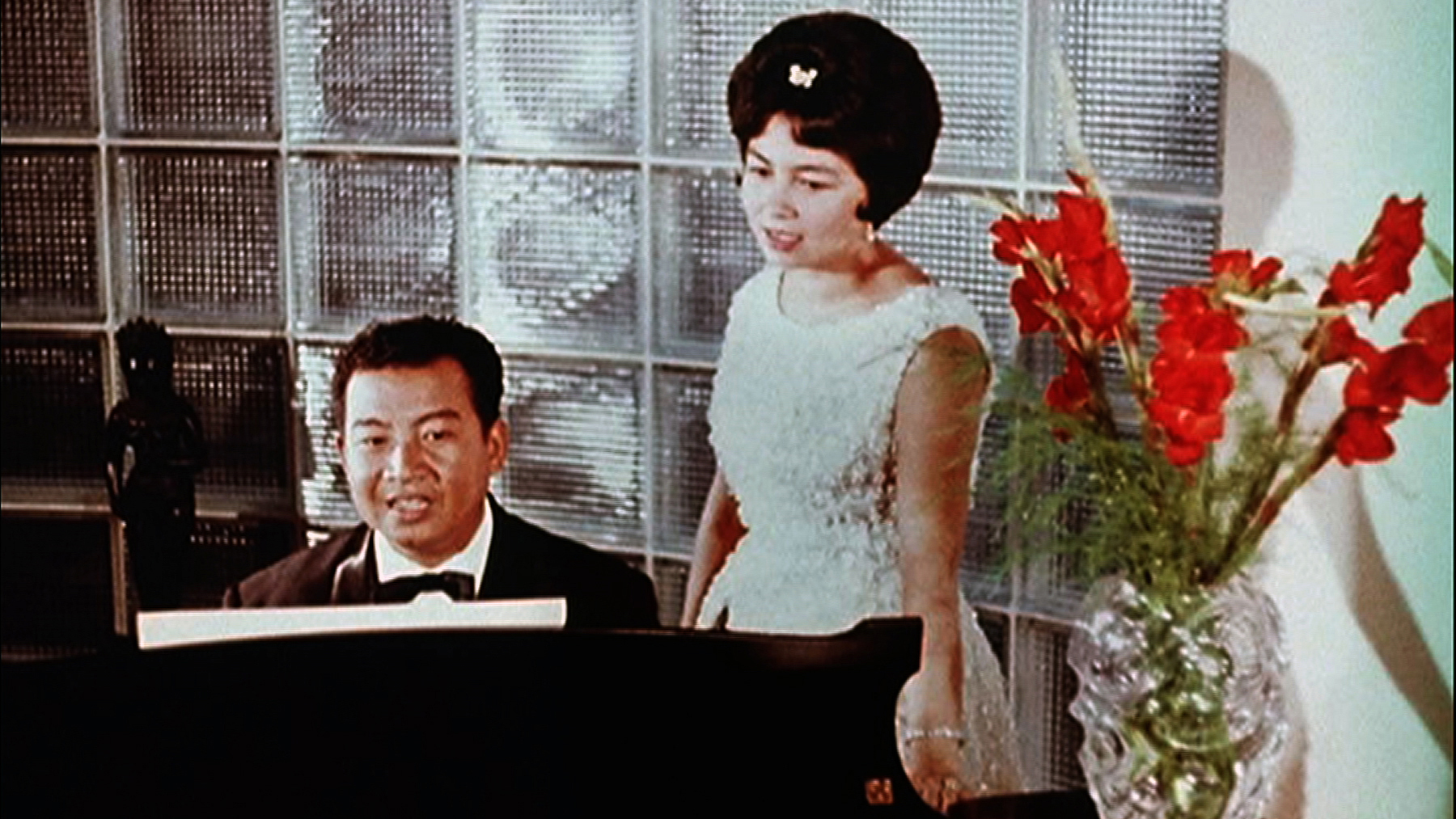 His Royal Majesty King Norodom Sihanouk and Her Royal Highness Norodom Monineath (film still courtesy of His Royal Majesty King Norodom Sihanouk)