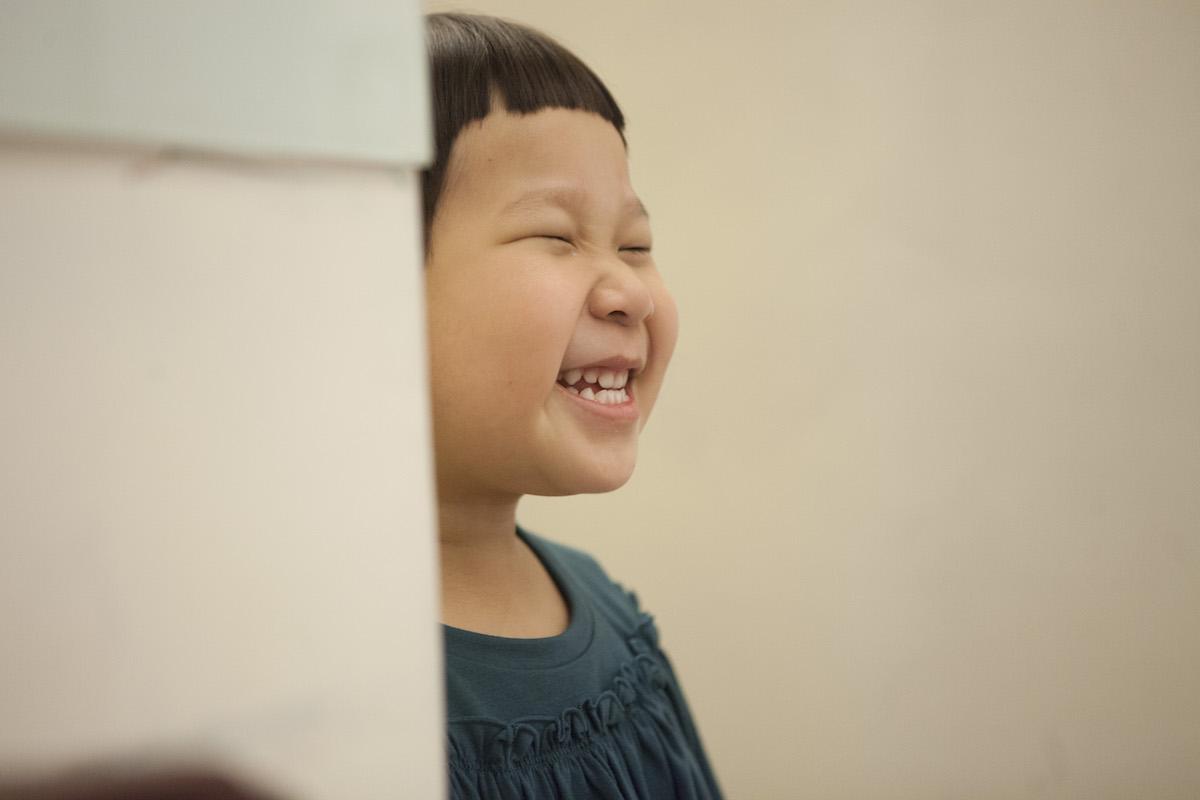 陳胖球的招牌笑容。